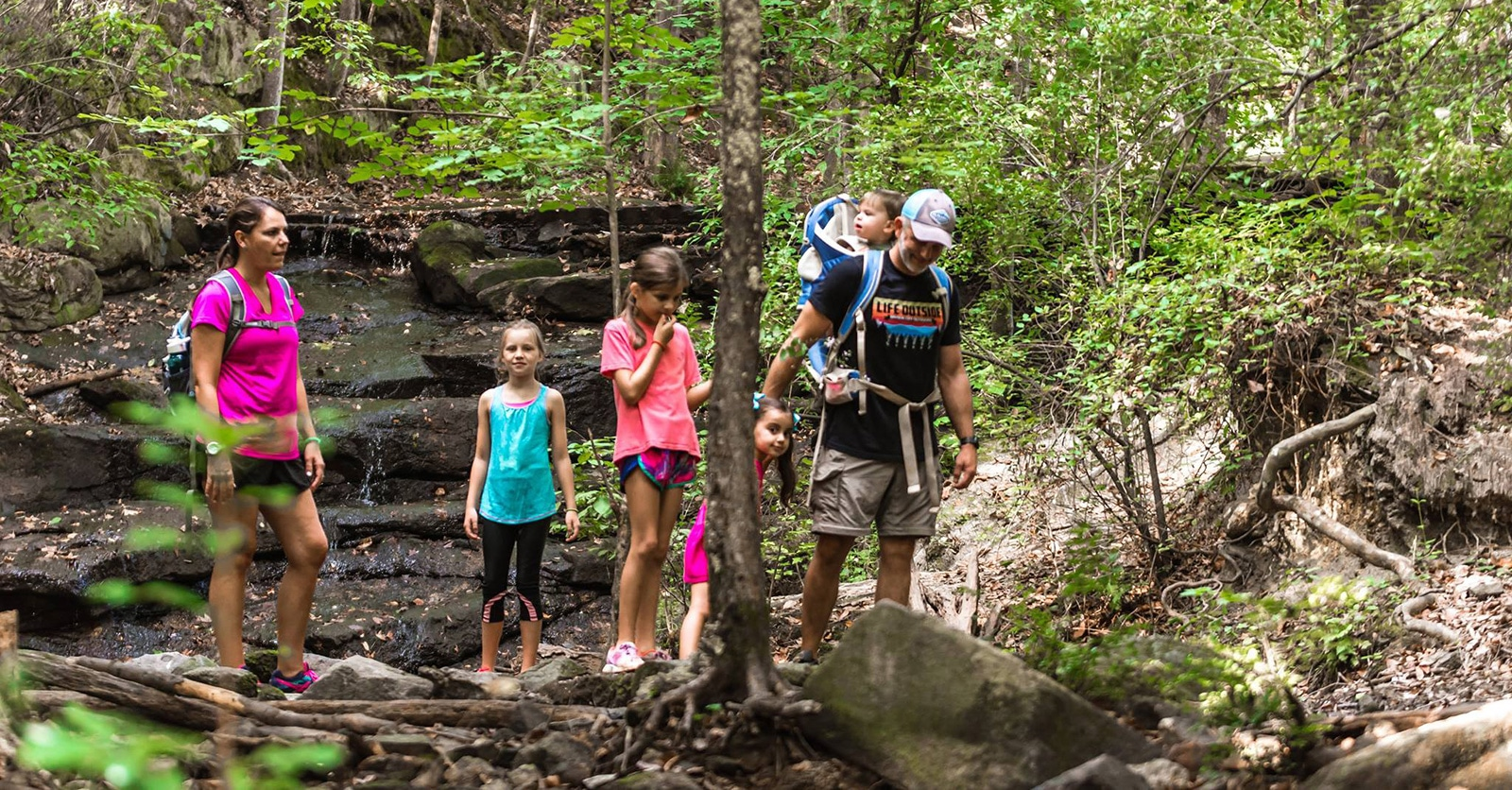Family hiking in the woods
