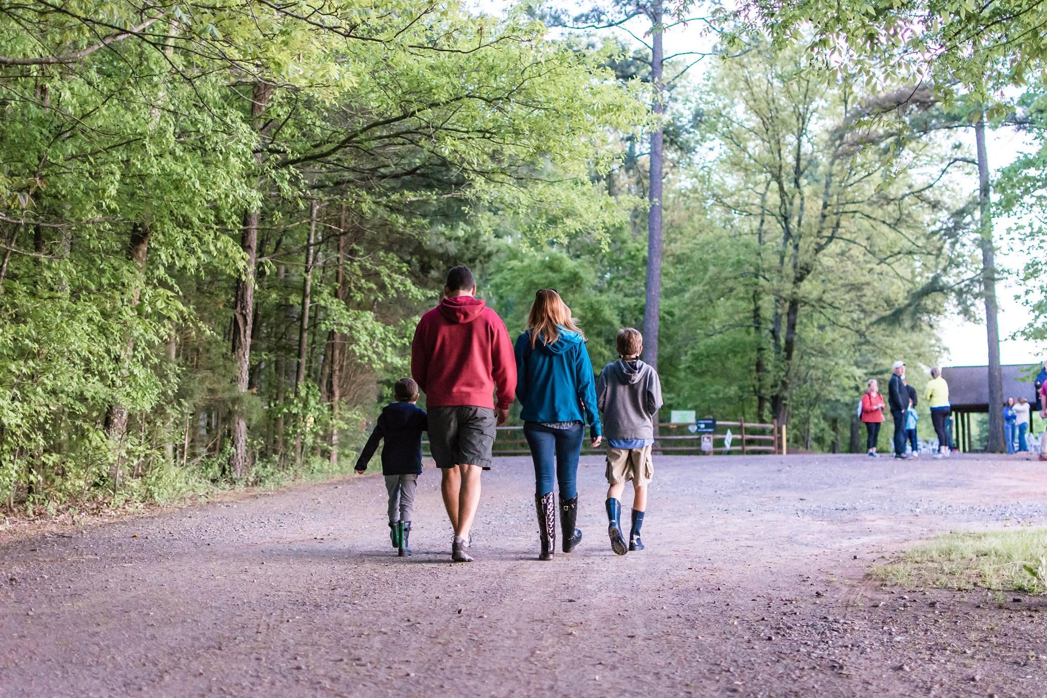Family walking down a path