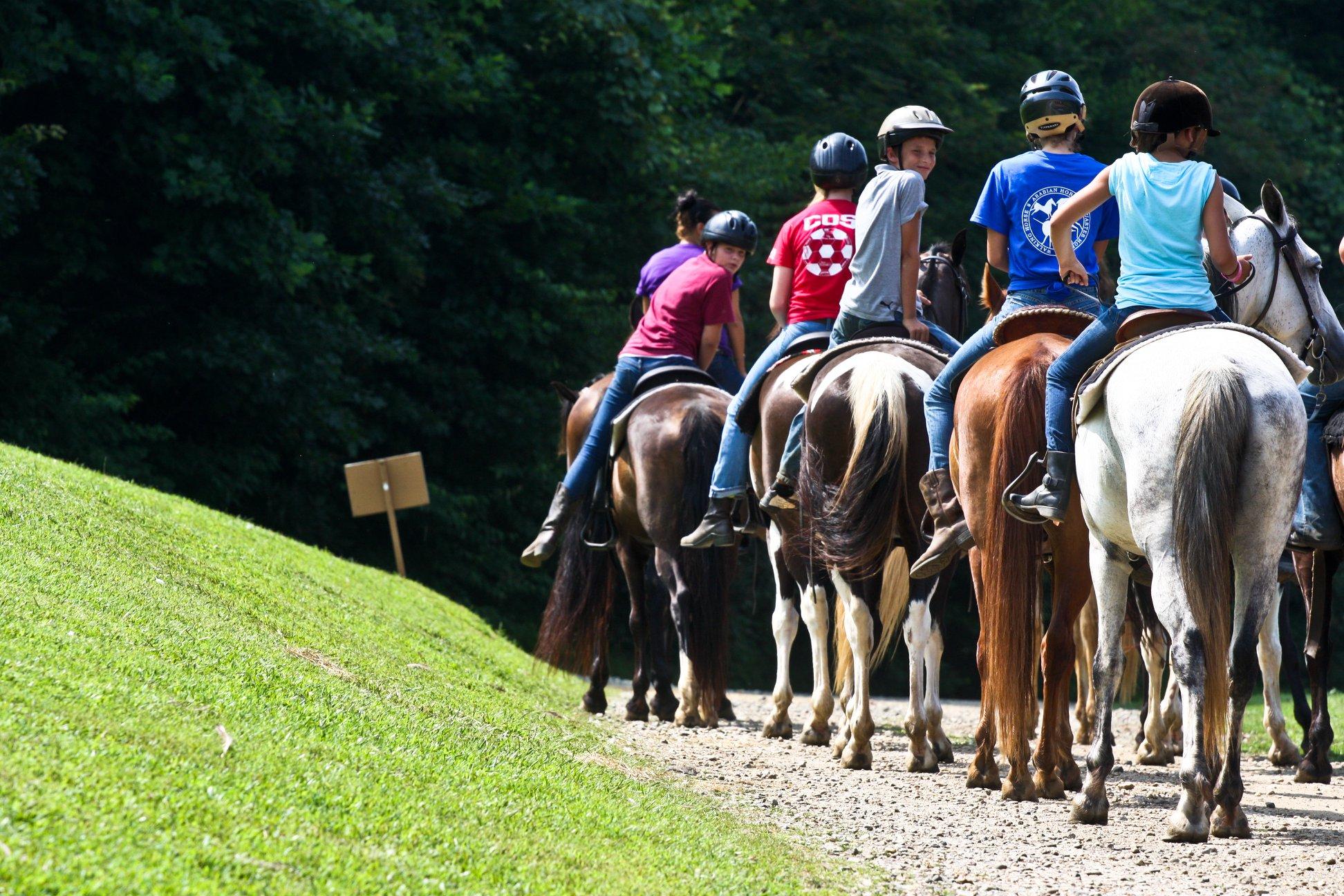 Girls riding horses at Greenway Summer Camp