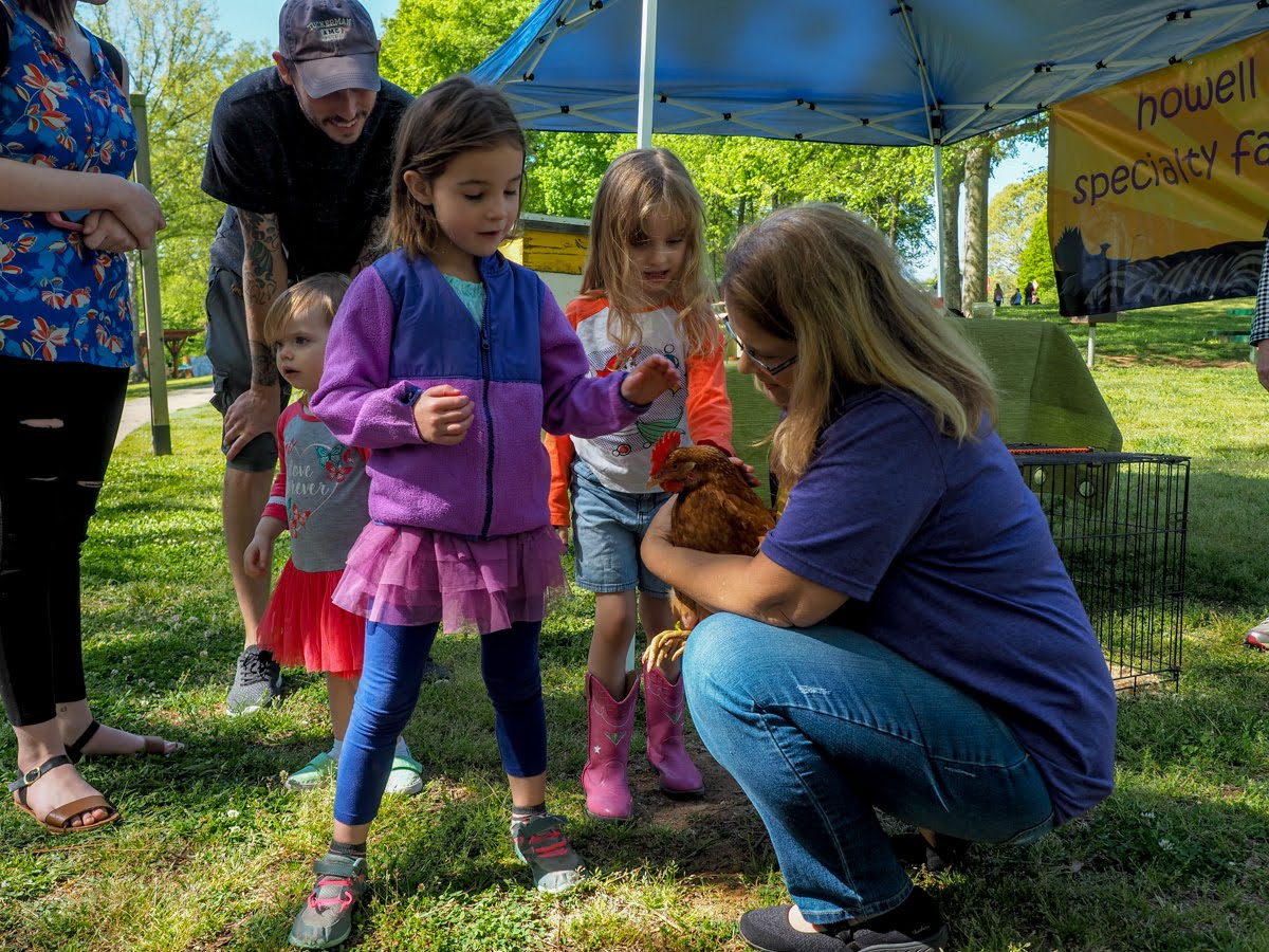Kids petting chicken at Earthday Celebration