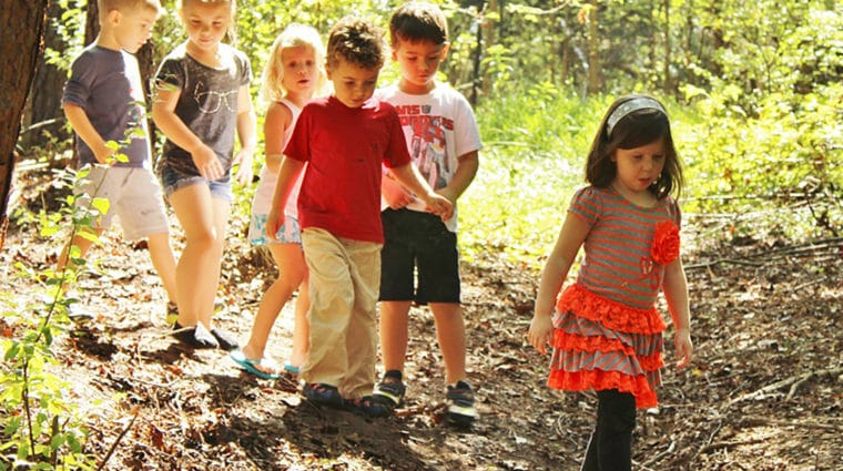 Kids walking a trail at outdoor preschool