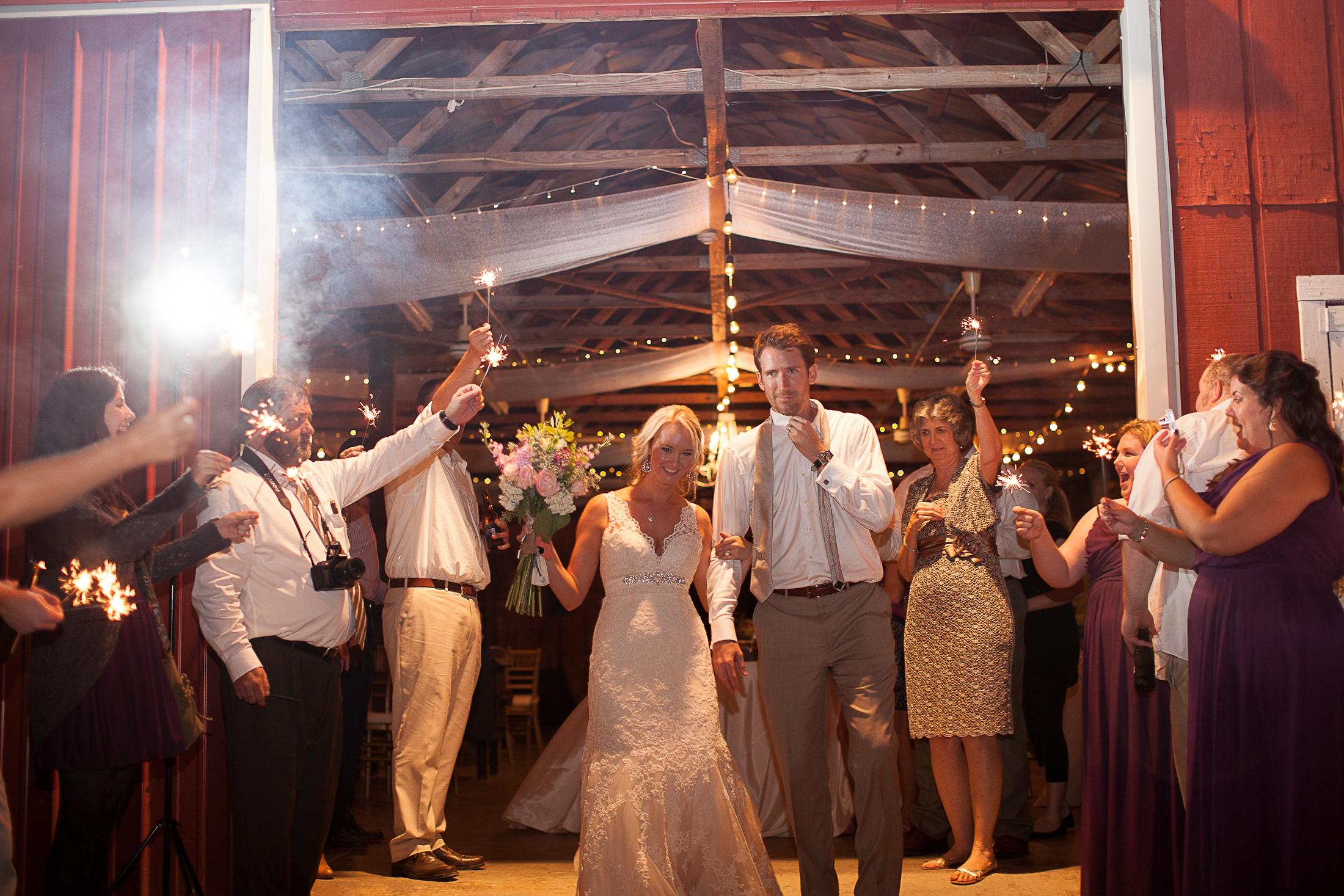 Wedding party dancing at Bob Reid Field Trail Barn