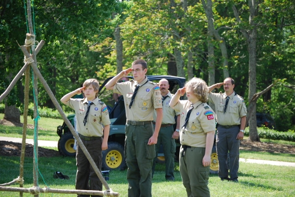 A group of boy scouts saluting