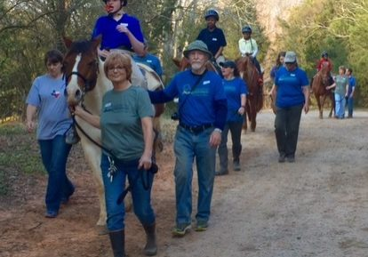 Volunteers with horses